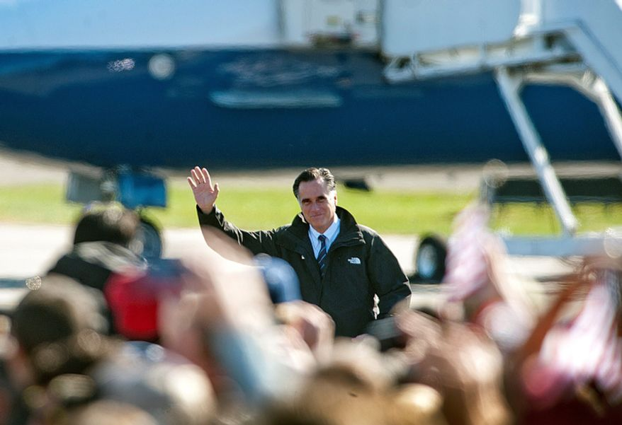 Republican presidential candidate, former Massachusetts Gov. Mitt Romney waves to supporters at a Virginia campaign rally at Lynchburg Regional Airport in Lynchburg, Va. on Monday Nov. 5, 2012. (AP Photo/The News & Advance, Jill Nance)
