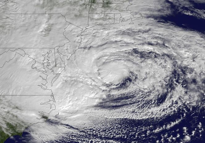 This NOAA satellite image taken on Monday, Oct. 29, 2012, shows Hurricane Sandy off the mid-Atlantic coastline moving toward the north with maximum sustained winds of 90 mph. Sandy wheeled toward land as forecasters feared, raking cities along the Northeast corridor with rain and wind gusts, flooding shore towns, washing away a section of the Atlantic City boardwalk, and threatening to cripple Wall Street and New York's subway system with a huge surge of corrosive seawater. (AP Photo/NOAA)