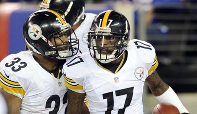 Pittsburgh Steelers wide receiver Mike Wallace (17) and Isaac Redman (33) celebrate after Wallace scored a touchdown during the second half of an NFL football game against the New York Giants, Sunday, Nov. 4, 2012, in East Rutherford, N.J. The Steelers won 24-20. (AP Photo/Bill Kostroun)