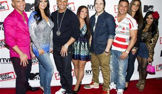 "** FILE ** This Oct. 24, 2012 photo shows ""Jersey Shore"" cast members, from left, Mike ""The Situation"" Sorrentino, Jenni ""JWoww"" Farley, Paul ""Pauly D"" Delvecchio, Deena Cortese, Vinny Guadagnino, Ronnie Ortiz-Magro, Sammi ""Sweetheart"" Giancola and Nicole ""Snooki"" Polizzi at a panel entitled ""Love, Loss, (Gym, Tan) and Laundry: A Farewell to the Jersey Shore"" in New York. MTV, home of the ""Jersey Shore"" reality show, plans to air a fundraising special to help rebuild New Jersey's devastated shoreline. The one-hour program will air Nov. 15 from MTV's Times Square studio in New York City. (Photo by Charles Sykes/Invision/AP, file)"
