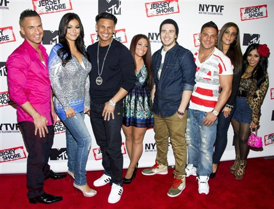 """** FILE ** This Oct. 24, 2012 photo shows """"Jersey Shore"""" cast members, from left, Mike """"The Situation"""" Sorrentino, Jenni """"JWoww"""" Farley, Paul """"Pauly D"""" Delvecchio, Deena Cortese, Vinny Guadagnino, Ronnie Ortiz-Magro, Sammi """"Sweetheart"""" Giancola and Nicole """"Snooki"""" Polizzi at a panel entitled """"Love, Loss, (Gym, Tan) and Laundry: A Farewell to the Jersey Shore"""" in New York. MTV, home of the """"Jersey Shore"""" reality show, plans to air a fundraising special to help rebuild New Jersey's devastated shoreline. The one-hour program will air Nov. 15 from MTV's Times Square studio in New York City. (Photo by Charles Sykes/Invision/AP, file)"""