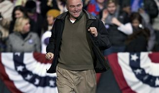 Democratic candidate for the U.S. Senate from Virginia, former Gov. Tim Kaine, runs to the stage to speak at a rally where President Obama and former President Bill Clinton appear later, Saturday night, Nov. 3, 2012, in Bristow, Va. (AP Photo/J. Scott Applewhite)