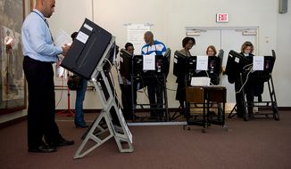 Washington residents take advantage of early voting at Judiciary Square in Washington on Wednesday, Oct. 24, 2012. According to voter site officials, some 2,400 voters had voted here since Monday, when the voting opened. (Barbara L. Salisbury/The Washington Times)