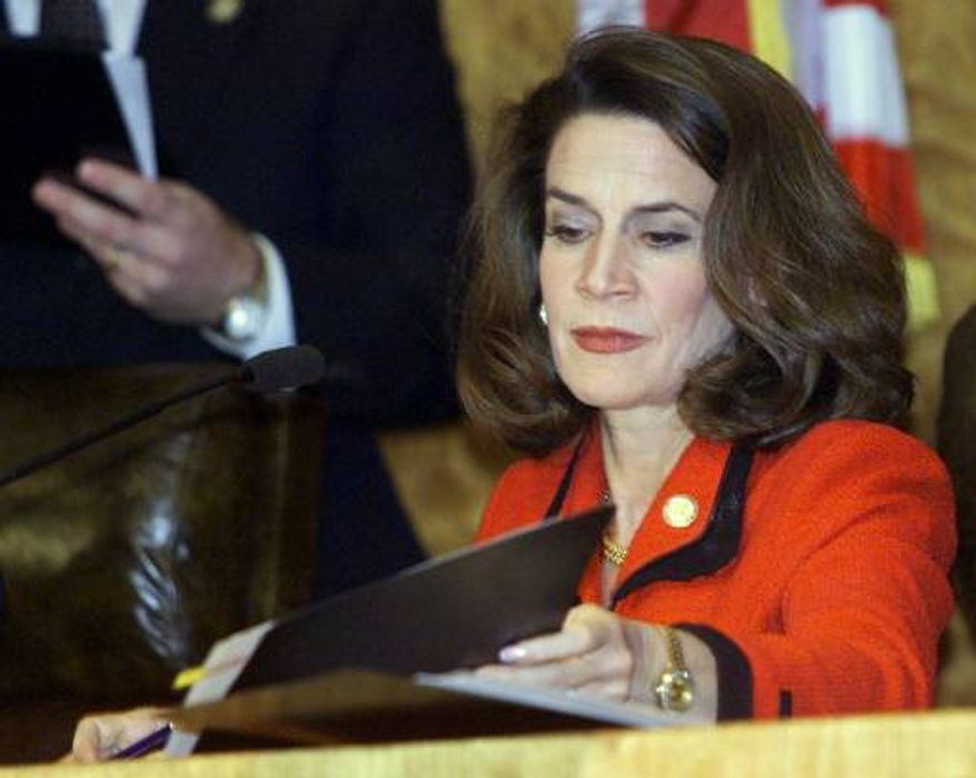 Florida Secretary of State Katherine Harris certifies the state's election during a news conference on Sunday, Nov. 26, 2000, in Tallahassee, Fla. (AP Photo/Beth A. Keiser)