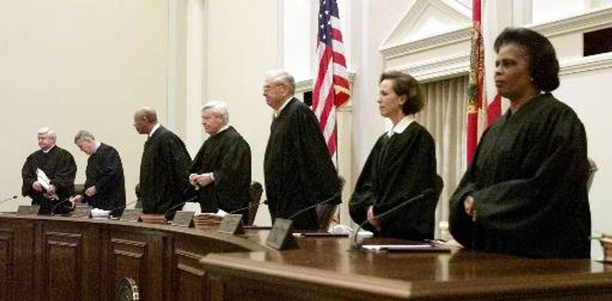 The Florida Supreme Court prepares to hear oral arguments in the state's election ballot recount case in Tallahassee, Fla., on Thursday, Dec. 7, 2000. Members of the Supreme Court are (from left) Justices R. Fred Lewis, Harry Lee Anstead, and Leander J. Shaw Jr.; Chief Justice Charles T. Wells; and Justices Major B. Harding, Barbara J. Pariente and Peggy A. Quince. (AP Photo/Palm Beach Post, Scott Wiseman, Pool)