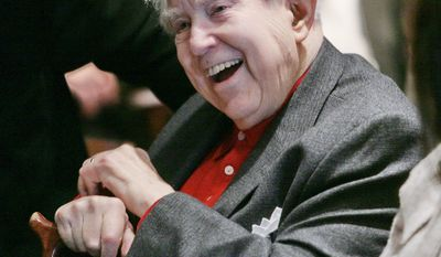Composer Elliott Carter was taking new commissions even as he celebrated his 100th birthday in December 2008. He died on Monday at age 103. (Associated Press)