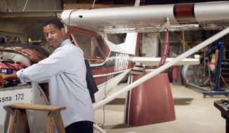 """Denzel Washington plays a pilot with a drinking problem in """"Flight."""" Anheuser-Busch wants the Budweiser logo and any other trademarks removed from the film. """"We … have a long history of promoting responsible drinking and preventing drunk driving,"""" said a Budweiser official. (Paramount Pictures via Associated Press)"""
