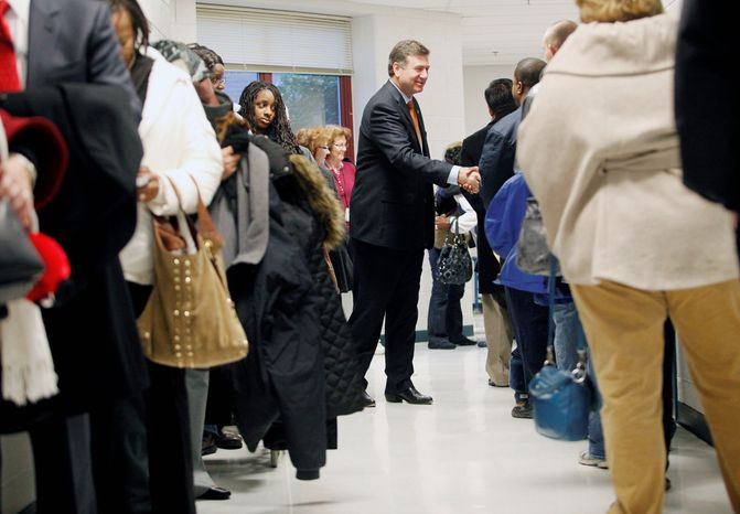 Virginia Senate candidate George Allen greets voters as they wait in line to vote at Washington Mill Elementary School in Alexandria, Va., on November 6, 2012. Allen was also there to vote with his wife Susan. (Eva Russo/Special to The Washington Times)