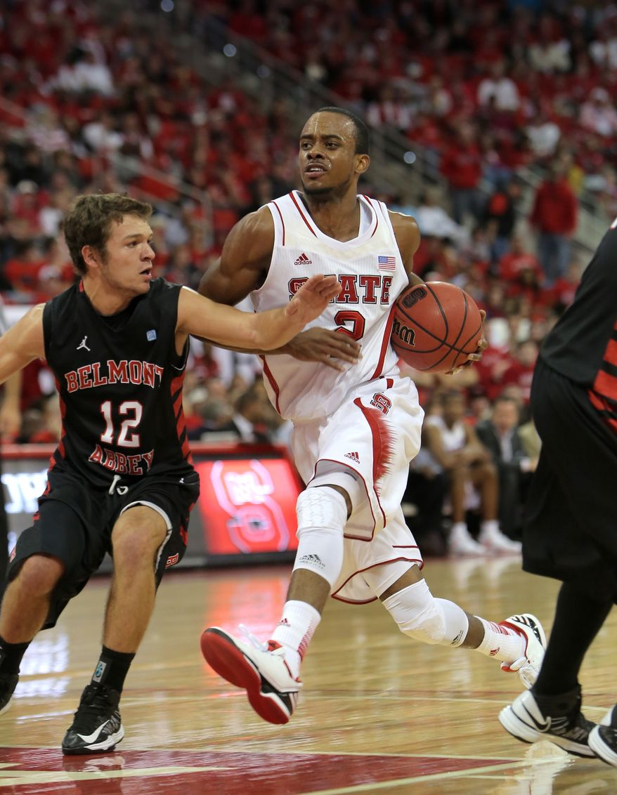 N.C. State's Lorenzo Brown drives to the basket against Belmont Abbey's Justin Kuhlman during the first half of a preseason NCAA college basketball game in Raleigh, N.C., Saturday, Nov. 3, 2012.  N.C. State won 105-80.  (AP Photo/Ted Richardson)