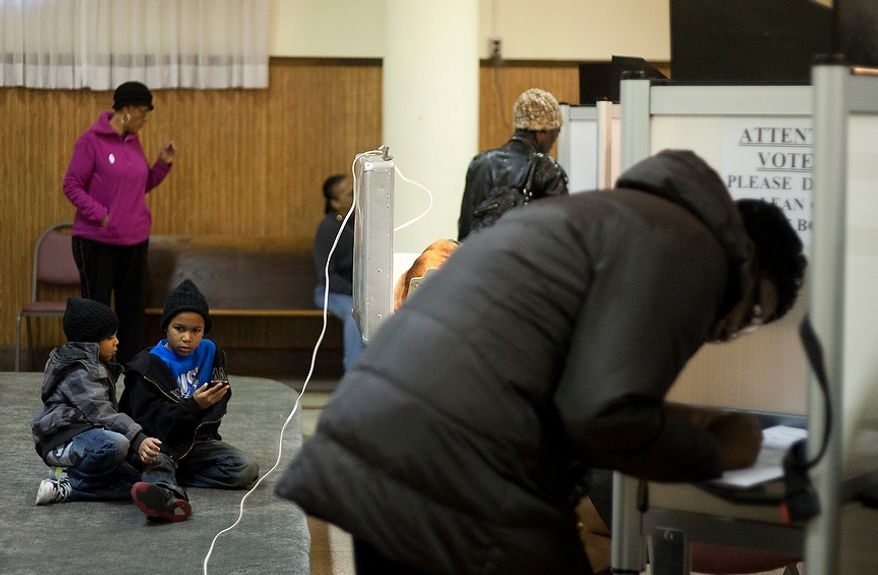 Children wait for their parents while they cast their ballots at St. Francis Church, precinct 111 polling site in Washington, D.C., to cast their vote, Tuesday, Nov. 6, 2012 (Craig Bisacre/The Washington Times)
