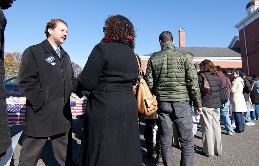 David Grosso, candidate running for at-Large City Council, shakes hands with voters outside of precinct 33 polling site in Washington, D.C., Tuesday, Nov. 6, 2012 (Craig Bisacre/The Washington Times)