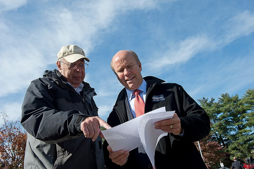 Jerry Garson (left) of the Ben Cardin campaign team, goes over data on Election Day with Maryland U.S. Congress hopeful John Delaney outside of Winston Churchill High School on Nov. 6, 2012. Delaney is hoping to oust Republican incumbent Roscoe Bartlett in the sixth district. (Barbara L. Salisbury/The Washington Times)