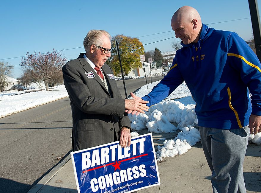 Maryland Rep. Roscoe Bartlett, a Republican, shakes hands with Grantsville, Md., Mayor Paul Edwards outside of Grantsville Elementary School on Election Day, Nov. 6, 2012. Bartlett, who is in a tight race against Democrat John Delaney, is visiting every county in his district on Election Day. (Barbara L. Salisbury/The Washington Times)