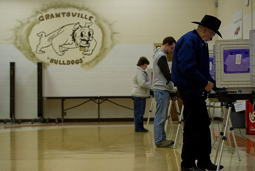 Russell Broadwater (right) and other voters cast their ballots on Election Day at Grantsville Elementary School in Grantsville, Md., on Nov. 6, 2012. The heavily Republican district has about 1,577 registered voters and had 100 people by 8 a.m. (Barbara L. Salisbury/The Washington Times)