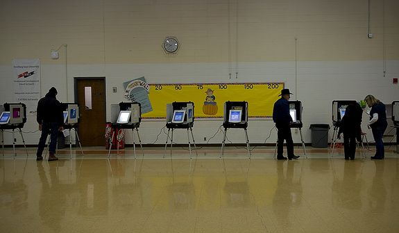 Garrett County residents vote at Grantsville Elementary School in Grantsville, Md., on Election Day, Nov. 6, 2012. The heavily Republican district has roughly 1,577 registered voters. They had about 100 by 8 a.m. and expected good turnout throughout the day. (Barbara L. Salisbury/The Washington Times)