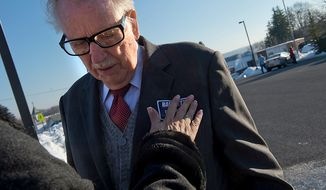 "Maryland Rep. Roscoe Bartlett gets his ""Bartlett for Congress"" sticker put on him by his chief of staff on Election Day outside of Grantsville Elementary School in Grantsville, Md., on Nov. 6, 2012. Bartlett, who is in a tight race against Democrat John Delaney, is visiting every county in his district on Election Day. (Barbara L. Salisbury/The Washington Times)"