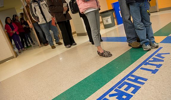 Voters wait in line on Election Day at Winston Churchill High School in Potomac, Md., on Nov. 6, 2012. (Barbara L. Salisbury/The Washington Times)