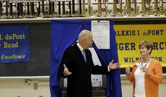 Vice President Joseph R. Biden exits a voting booth after casting his ballot at Alexis I. duPont High School in Greenville, Del., on Tuesday, Nov. 6, 2012. (AP Photo/Matt Rourke)