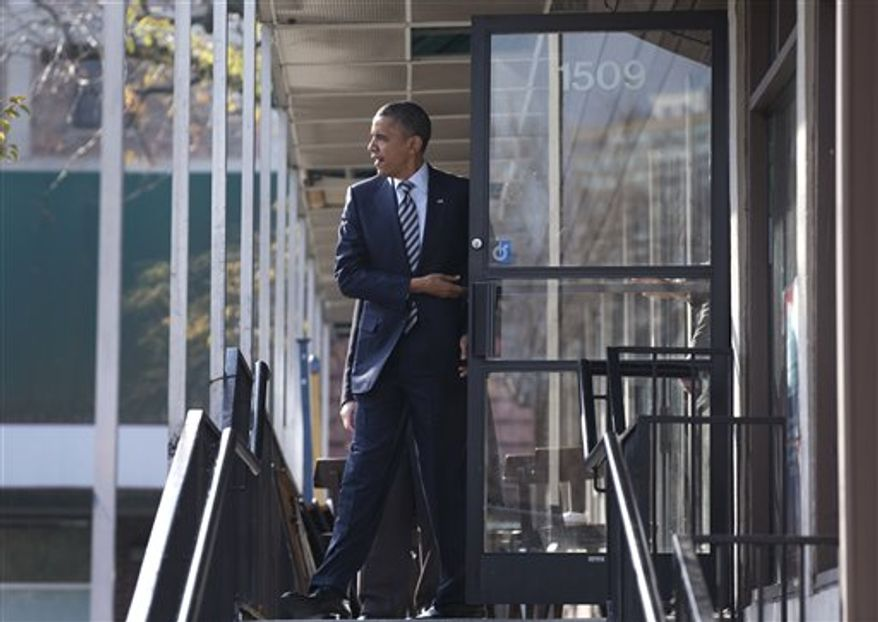 President Obama leaves a campaign office the morning of the 2012 election, Tuesday, Nov. 6, 2012, in Chicago, after visiting with volunteers, making phone calls and speaking to the media. (AP Photo/Carolyn Kaster)