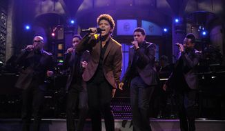 "Guest host Bruno Mars performs on ""Saturday Night Live"" in New York on Saturday, Oct. 20, 2012. (AP Photo/NBC, Dana Edelson)"