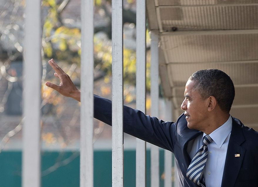 President Barack Obama waves to people as he leaves a campaign office the morning of the 2012 election, Tuesday, Nov. 6, 2012, in Chicago. (AP Photo/Carolyn Kaster)