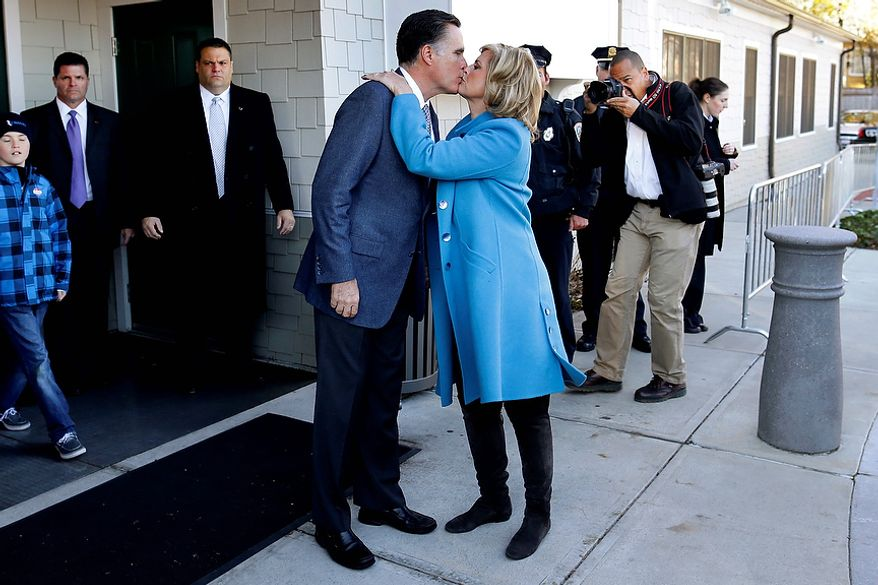 Republican presidential candidate, former Massachusetts Gov. Mitt Romney kisses wife Ann Romney after they voted in Belmont, Mass., Tuesday, Nov. 6, 2012.(AP Photo/Charles Dharapak)