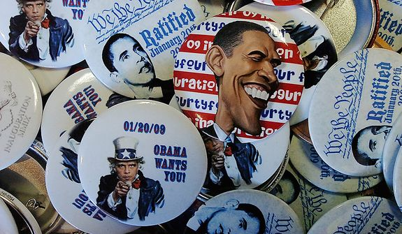 President Barack Obama buttons at the Obama field office located on Wyoming Avenue  in Scranton, Pa., on Tuesday, Nov. 6, 2012 during Election Day.  (AP Photo/Scranton Times & Tribune, Butch Comegys)