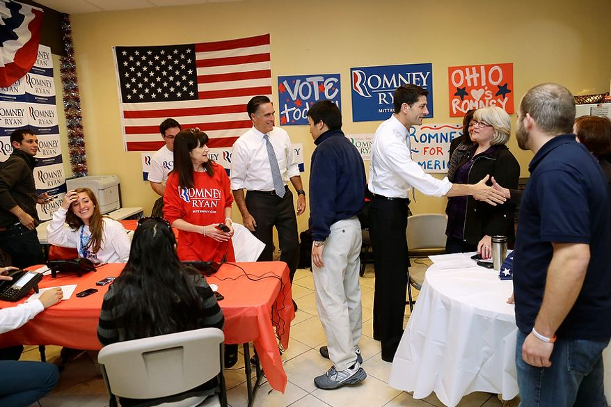 Republican presidential candidate, former Massachusetts Gov. Mitt Romney and his vice presidential running mate, Rep. Paul Ryan, R-Wis., greet campaign workers at a call center in Richmond Heights, Ohio, on Election Day, Tuesday, Nov. 6, 2012. (AP Photo/Charles Dharapak)
