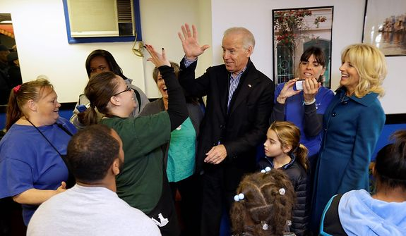 Vice President Joe Biden, accompanied by his wife Jill Biden, right, and granddaughter Natalie, meets with patrons during a visit to the Landmark Restaurant, Tuesday, Nov. 6, 2012, in Cleveland, Ohio. (AP Photo/Matt Rourke)