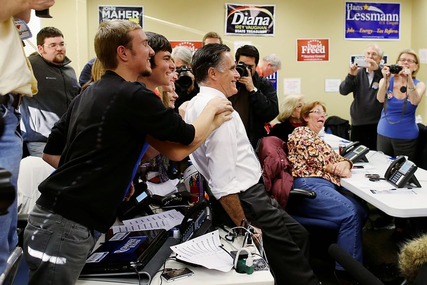 Republican presidential candidate, former Massachusetts Gov. Mitt Romney poses with campaign workers during a visit to a voter call center in Green Tree, Pa., Tuesday, Nov. 6, 2012. (AP Photo/Charles Dharapak)