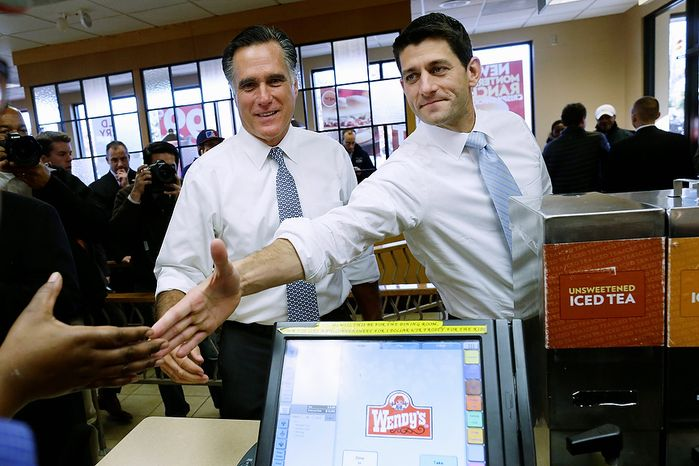 Republican presidential candidate, former Massachusetts Gov. Mitt Romney and his vice presidential running mate, Rep. Paul Ryan, R-Wis., make an unscheduled stop at a Wendy's restaurant in Richmond Heights, Ohio, on Election Day, Tuesday, Nov. 6, 2012. (AP Photo/Charles Dharapak