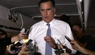 Republican presidential candidate and former Massachusetts Gov. Mitt Romney speaks to reporters en route from Pittsburgh to Boston, Tuesday, Nov. 6, 2012. (AP Photo/Charles Dharapak)