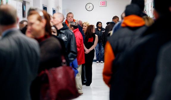 The line of voters winds its way through the halls of Washington Mill Elementary School in Alexandria, Va., before 7 a.m. on Nov. 6, 2012. Voters were already lined up outside the school when the polls opened at 6 a.m. (Eva Russo/Special to The Washington Times)