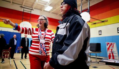 Special assistant election officer Belinda Strickland directs voters at Washington Mill Elementary School in Alexandria, Va., on Nov. 6, 2012. (Eva Russo/Special to The Washington Times)