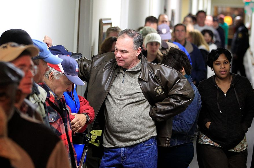 Democratic Senate candidate and former Virginia Gov. Timothy Kaine and his wife, Anne Holton, wait in line to vote in Richmond, Va., on Nov. 6, 2012. (Associated Press)