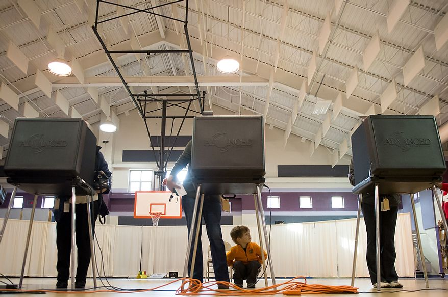 Evan Berry, 3, waits for his mother, Sarah Berry of Richmond, Va., center, as she votes at Linwood Holton Elementary on election day morning, Richmond, Va., Tuesday, November 6, 2012. Sarah Berry says she remembers being pregnant with Evan when she voted in the last presidential election, 4 years ago. (Andrew Harnik/The Washington Times)