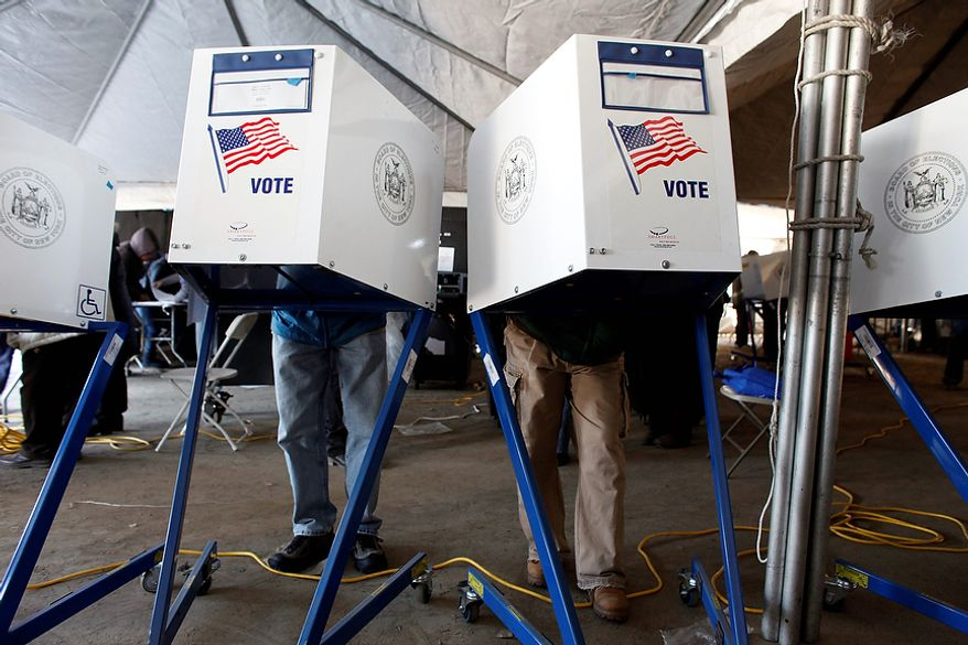 Voters fill out their ballots under a tent at a consolidated polling station for residents of the Rockaways on Election Day, Tuesday, Nov. 6, 2012, in the Queens borough of New York. (AP Photo/Jason DeCrow) ** FILE **