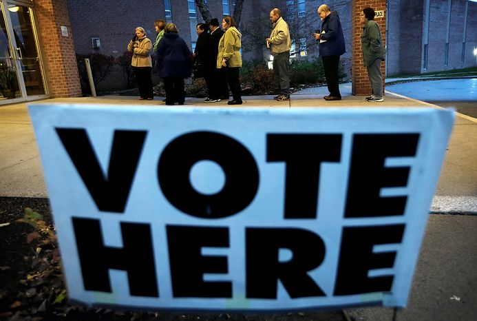 Voters wait in line for the doors to Precinct 39 to open before casting their ballots on Election Day, Tuesday, Nov. 6, 2012, at the First Church of the Open Bible in Des Moines, Iowa. (AP Photo/Charlie Neibergall)