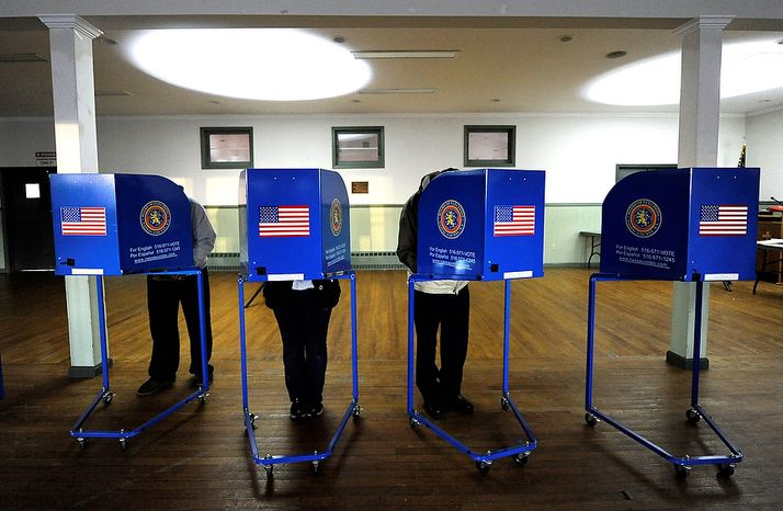 Early morning voting is under way at Bishop Molloy Recreational Center on Tuesday, Nov. 6, 2012, in Point Lookout, N.Y., one of several voting locations that were created as a result of superstorm Sandy. (AP Photo/Kathy Kmonicek)
