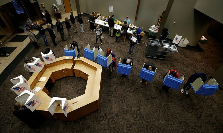 Voters in Precinct 39 fill out their ballots while voting on Election Day, Tuesday, Nov. 6, 2012, at the First Church of the Open Bible in Des Moines, Iowa. (AP Photo/Charlie Neibergall)