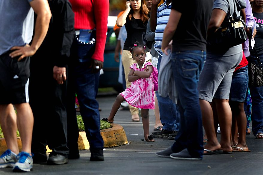Kezia Gipson, 3, waits with her grandparents Doris Ross and Freddie Irvin in a voting line at the International Longshoreman's Association Office in Ft. Lauderdale, Fla.Tuesday, Nov. 6, 2012. After a grinding presidential campaign President Barack Obama and Republican presidential candidate, former Massachusetts Gov. Mitt Romney, yield center stage to American voters Tuesday for an Election Day choice that will frame the contours of government and the nation for years to come. (AP Photo/The Miami Herald,Joe Rimkus Jr. )  MAGS OUT