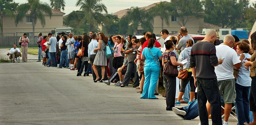 Voters wait in line tocast their ballots at a polling station, Tuesday, Nov. 6, 2012, in Miami. After a grinding presidential campaign President Barack Obama and Republican presidential candidate, former Massachusetts Gov. Mitt Romney, yield center stage to American voters Tuesday for an Election Day choice that will frame the contours of government and the nation for years to come. (AP Photo/The Miami Herald, Tim Chapman)  MAGS OUT