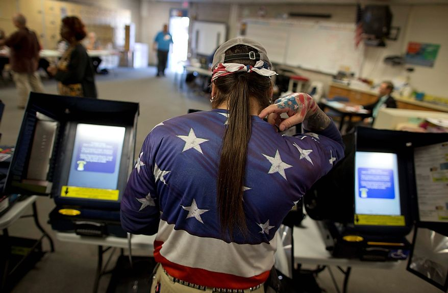 "Victor ""Snake Mann"" Wolder, marks his choices while voting during Election Day, Tuesday, Nov. 6, 2012, in Las Vegas. (AP Photo/Julie Jacobson)"