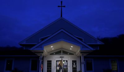 A man walks into his polling place, Star Bridge Christian Center, before sunrise to cast his ballot in the general election Tuesday, Nov. 6, 2012, in Wildwood, Mo. (AP Photo/Jeff Roberson)