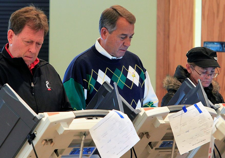 House Speaker John A. Boehner (center), Ohio Republican, votes at the Ronald Reagan Lodge on Tuesday, Nov. 6, 2012, in West Chester, Ohio. After a grinding presidential campaign, Americans are heading into polling places across the country. (AP Photo/Al Behrman)