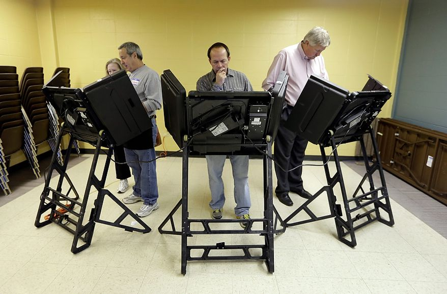 Voters cast their ballots in the general election at Kirkwood Community Center Tuesday, Nov. 6, 2012, in Kirkwood, Mo.  (AP Photo/Jeff Roberson)