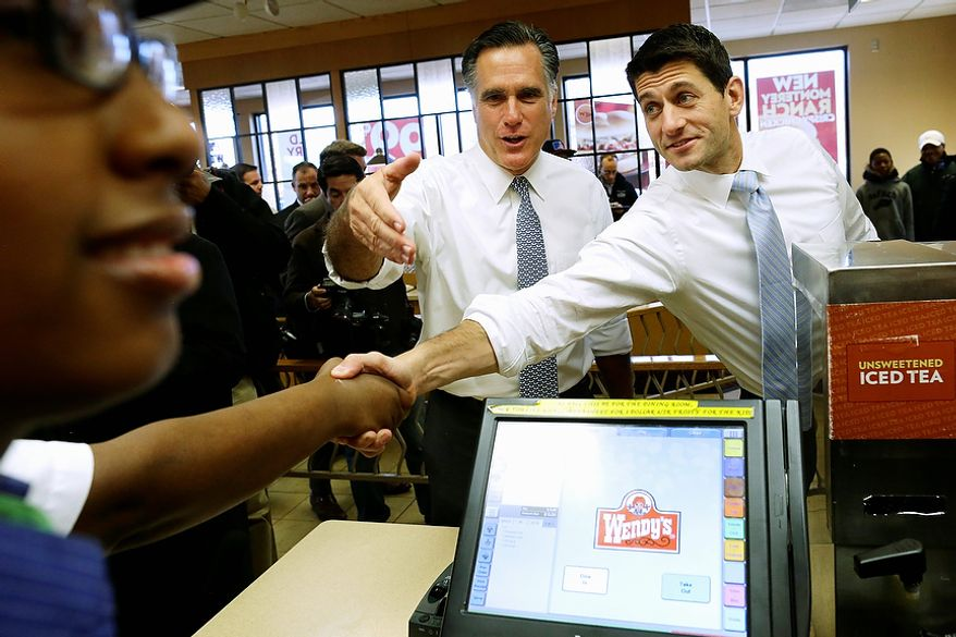 Republican presidential candidate, former Massachusetts Gov. Mitt Romney and his vice presidential running mate, Rep. Paul Ryan, R-Wis., make an unscheduled stop at a Wendy's restaurant in Richmond Heights, Ohio, on Election Day, Tuesday, Nov. 6, 2012. (AP Photo/Charles Dharapak)