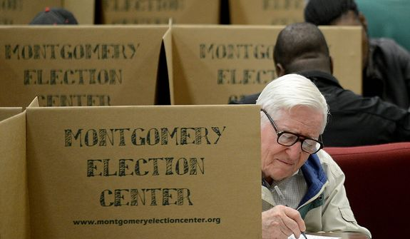 Mervel Parker fills out his ballot to vote in the election at Aldersgate United Methodist Church in Montgomery, Ala., Tuesday, Nov. 6, 2012. (AP Photo/The Montgomery Advertiser, Julie Bennett)