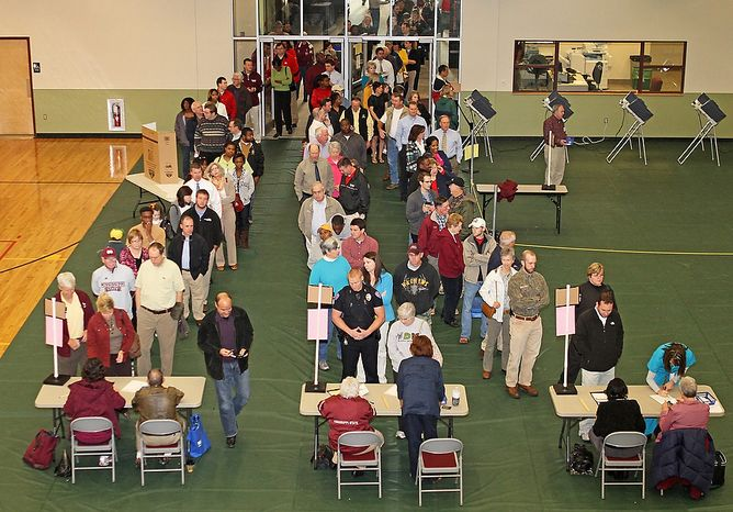 Voters pack the South Starkvile Voting Precinct trying to get their vote in before heading to work on Tuesday, Nov. 6, 2012 in Starkville, Miss.  (AP Photo/Kerry Smith)