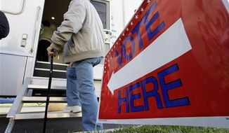 A man waits his turn to vote at a Mobile Voting Precinct van Monday, Nov. 5, 2012, in Burlington, N.J. Many victims displaced by Superstorm Sandy are taking advantage of offers to vote early. (AP Photo/Mel Evans)